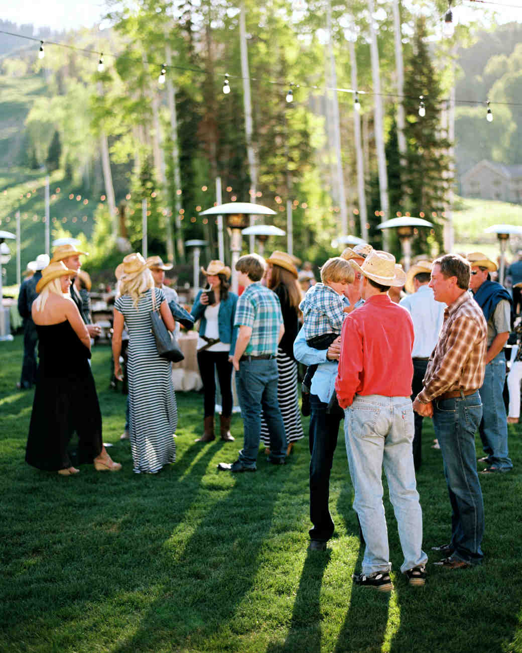 guests mingle outdoors cowboy hats