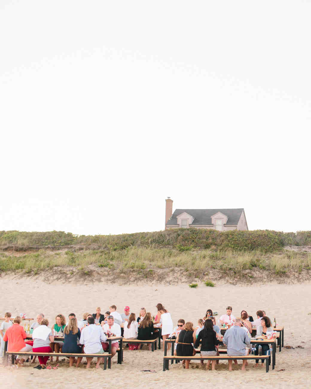 guests at tables on beach