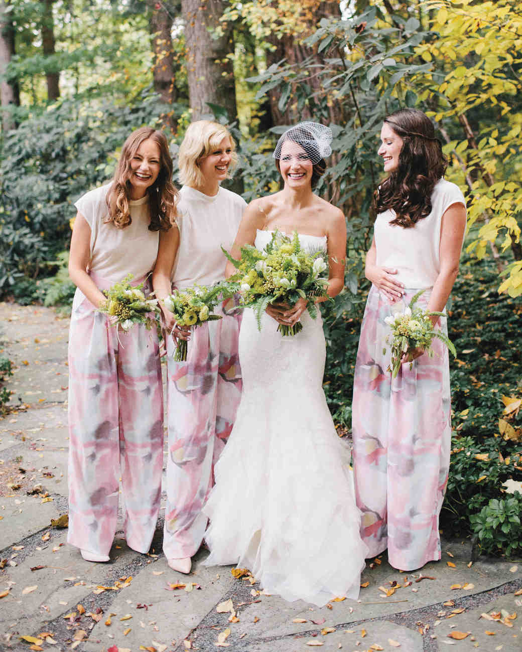 bridesmaids in white shirts and patterned pants