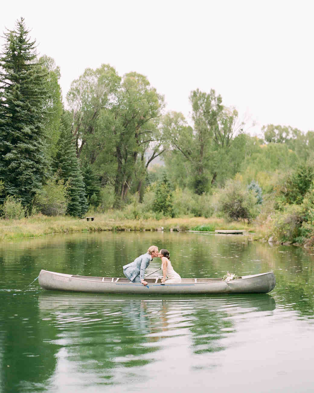 margaux patrick wedding couple canoe kiss