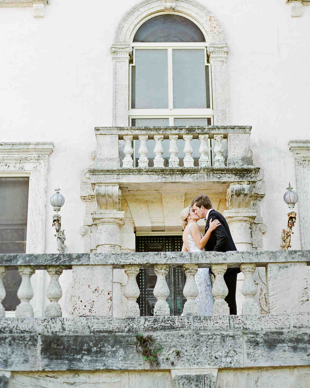 natalie jamey wedding couple balcony kiss
