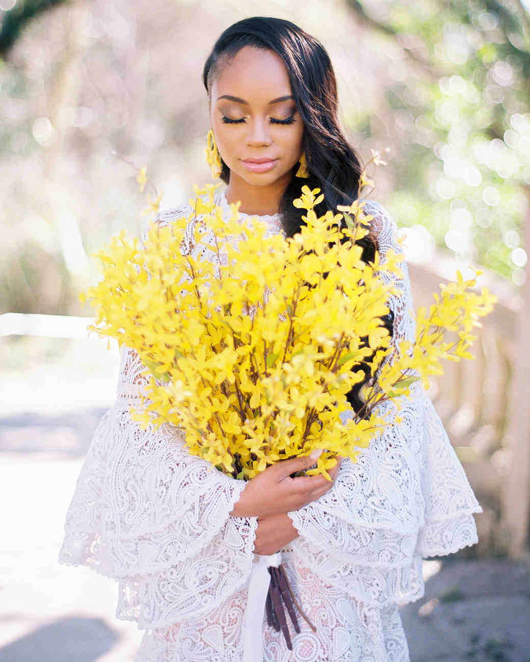 bride holding neon yellow flower bouquet