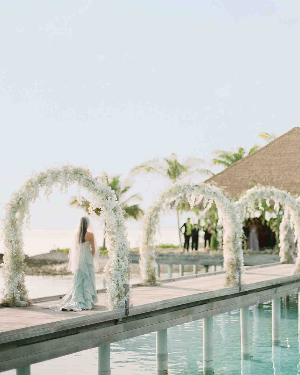 Boardwalk Ceremony Aisle with White Arches