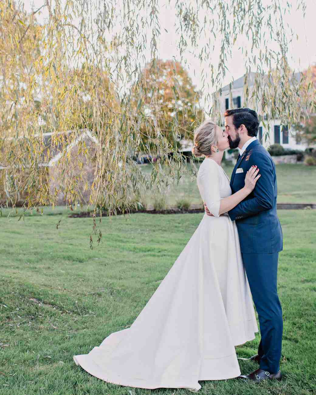 A charmingly bespoke fall wedding in new jersey martha stewart wedding couple kiss junglespirit Gallery