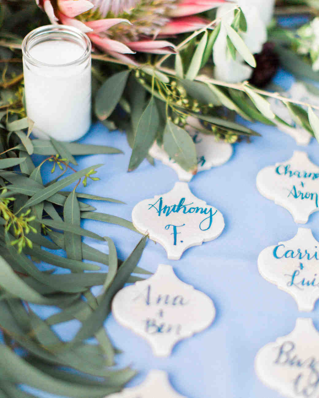 guests names on lantern-shaped escort card tiles