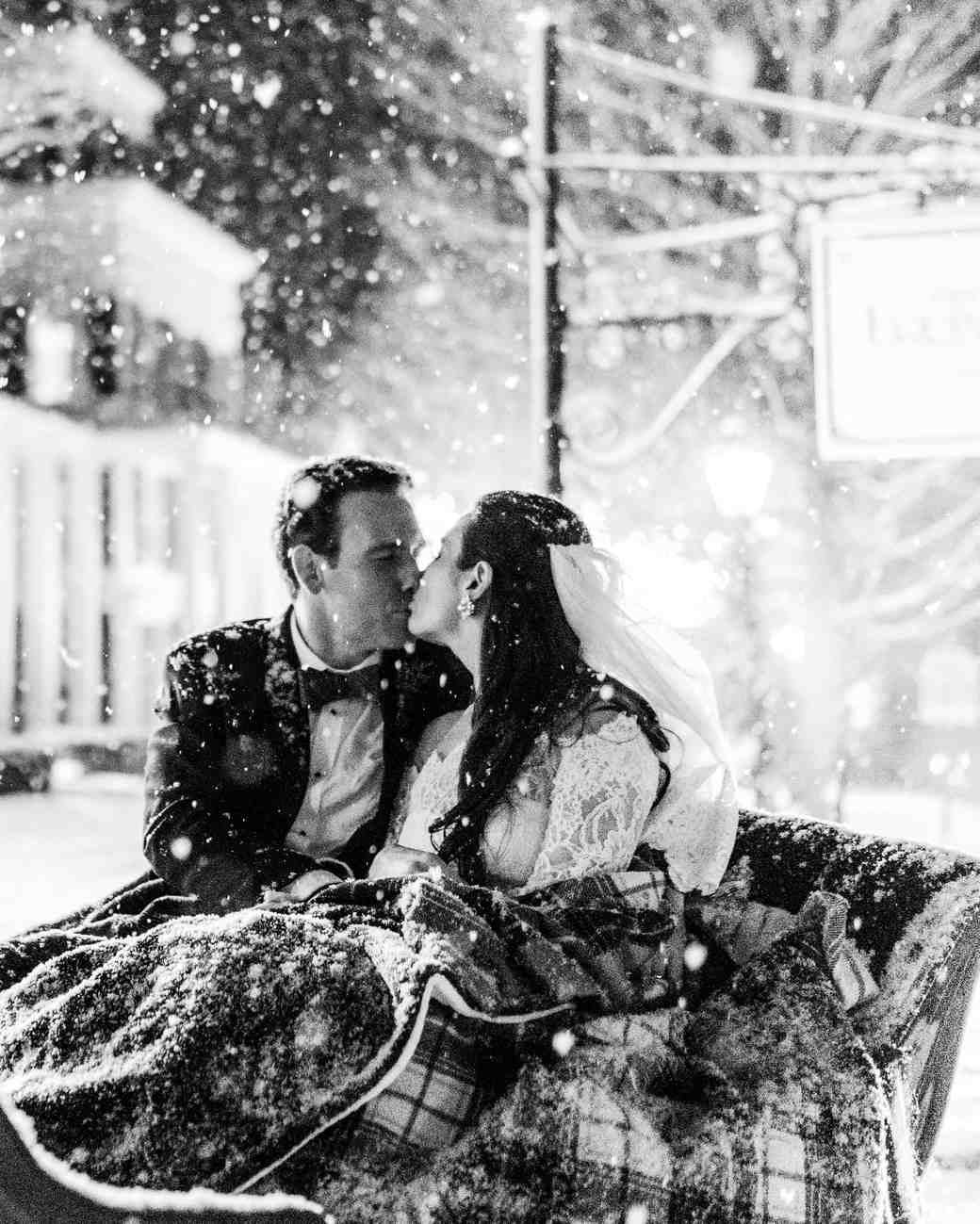 lauren christian christmas wedding carriage ride bride groom snowing