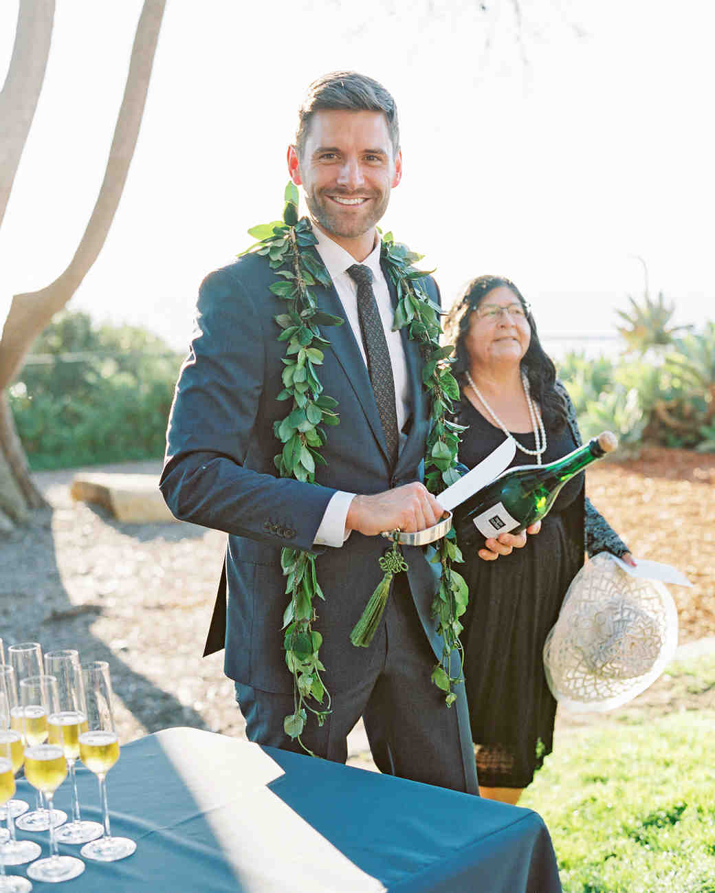 rob franco wedding saber champagne