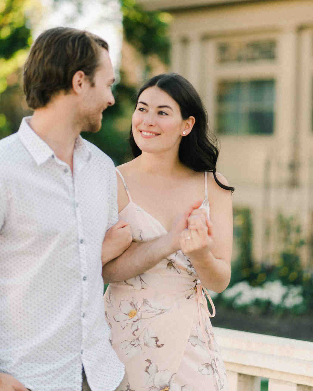 couple holding hands engagement photo