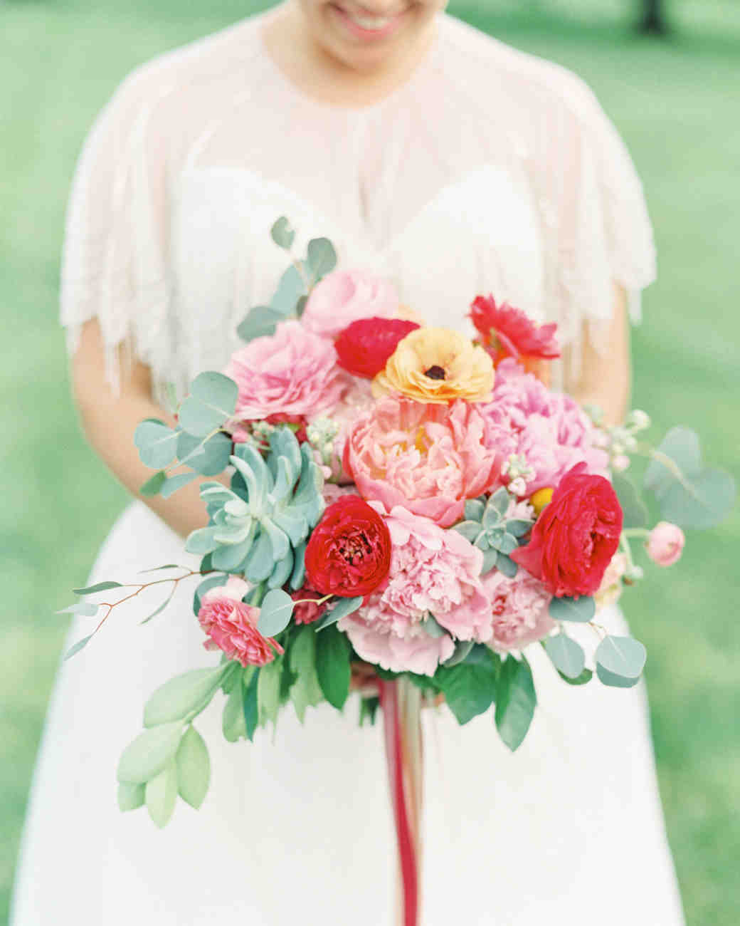 Bride Holding Bright Pink and Red Bouquet