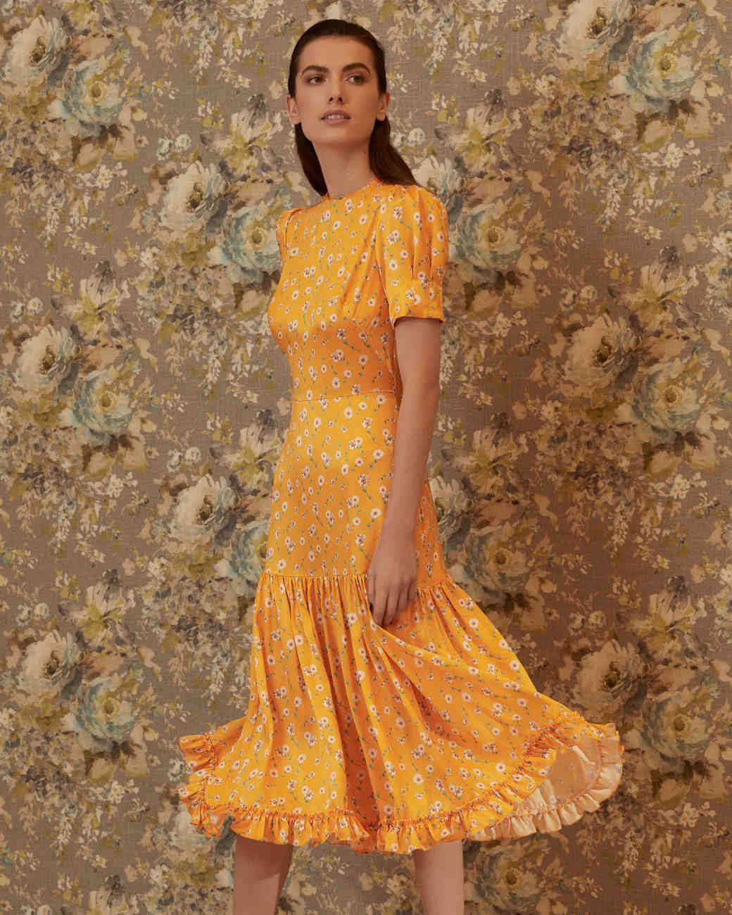 yellow silk midi dress with puff sleeves and daisy floral print