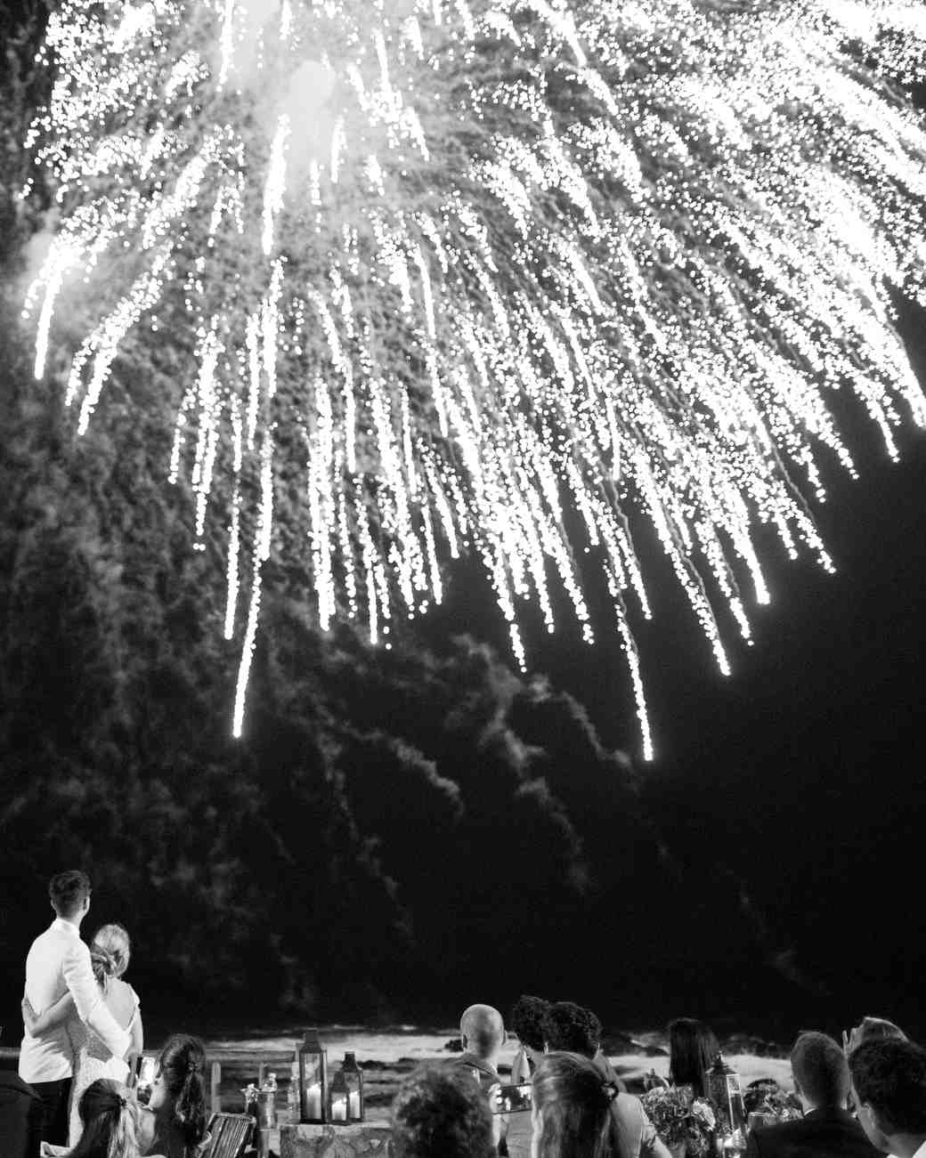 wedding attendees beneath fireworks