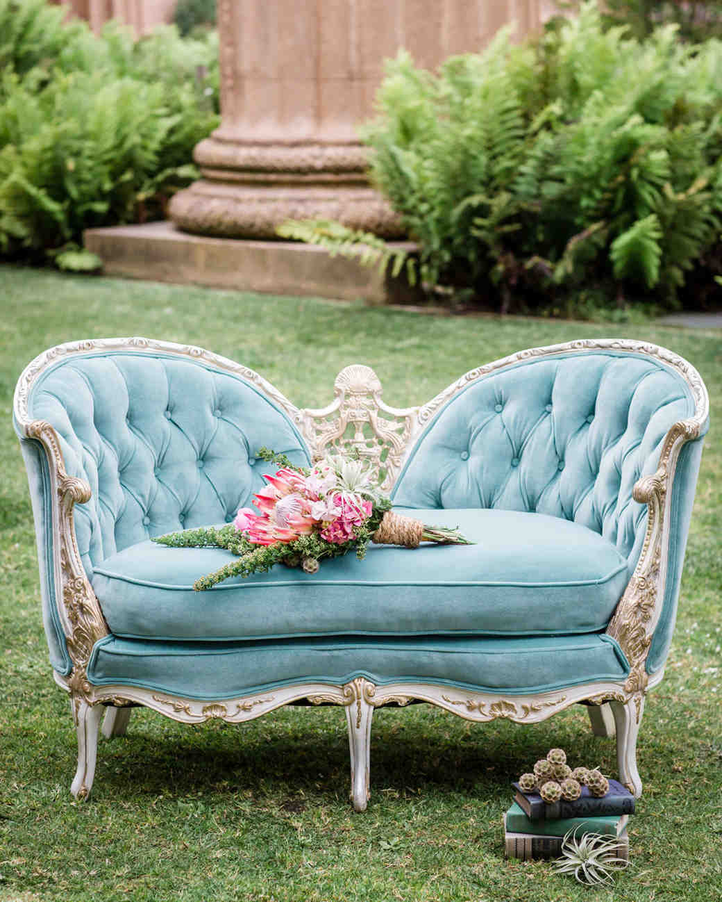 blue velvet chaise lounge on lawn