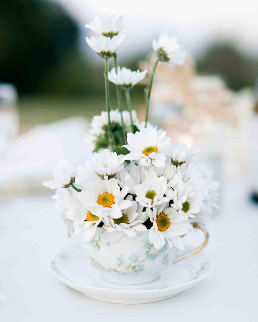white flowers wedding centerpiece tea cup saucer