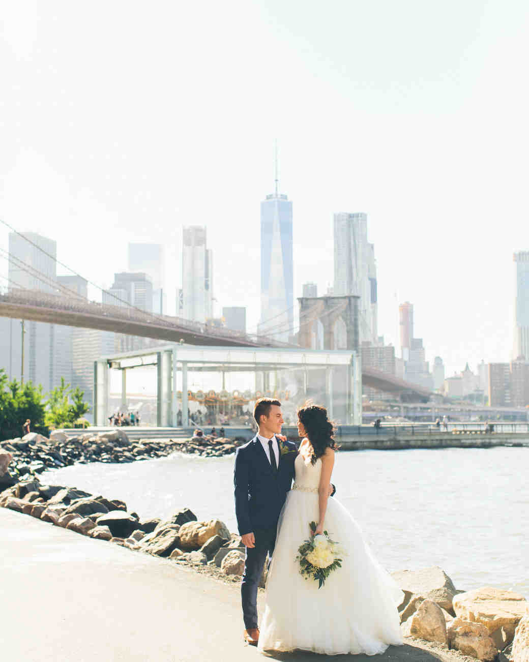 couple standing in front of new york city skyline