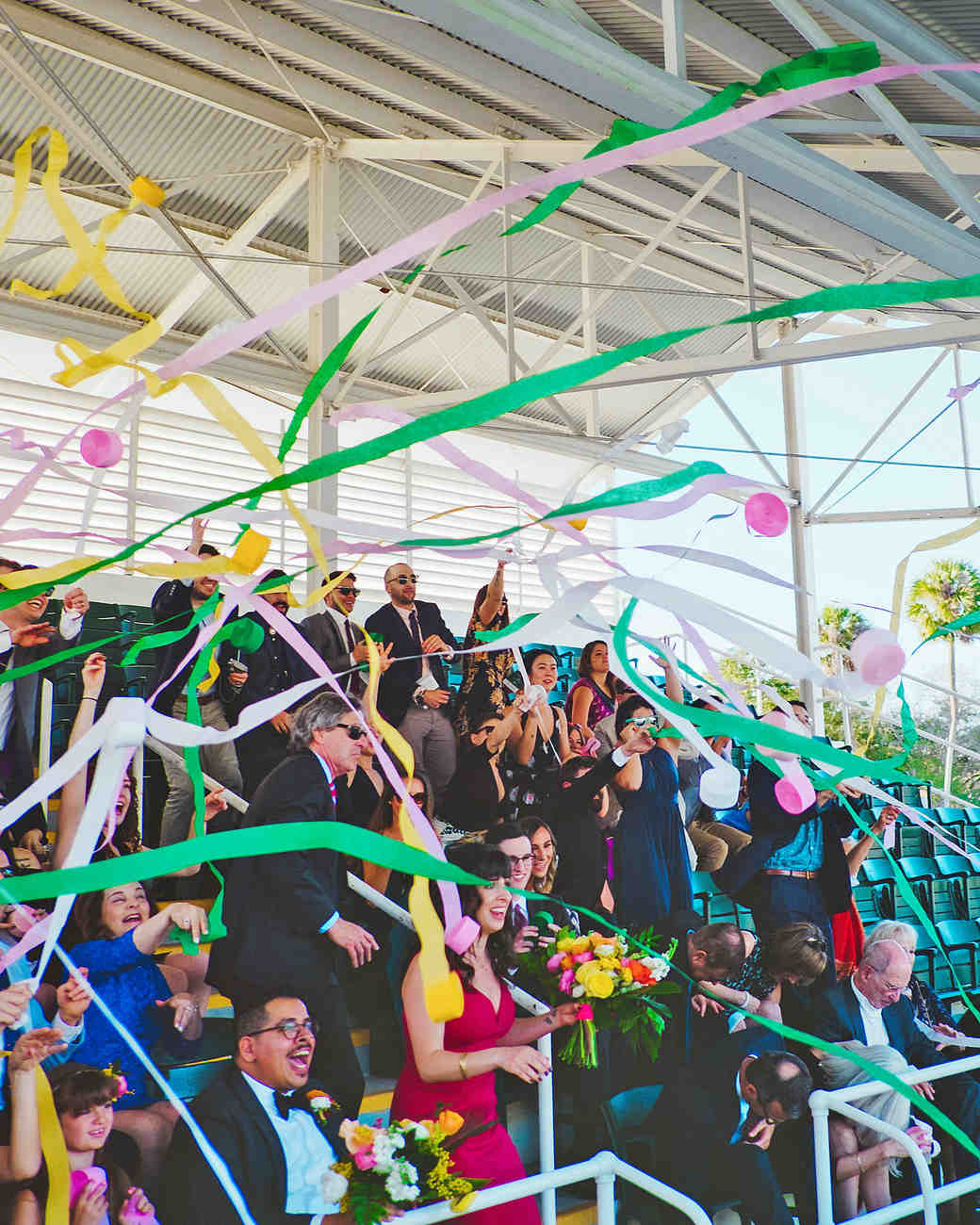 becca zac wedding ceremony streamers from crowd