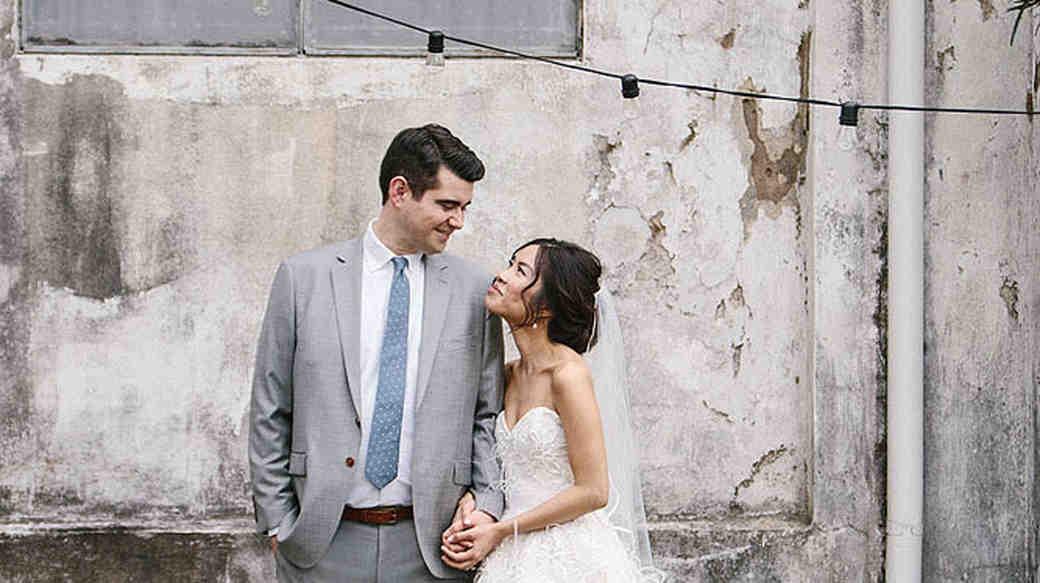 wedding couple portrait concrete wall