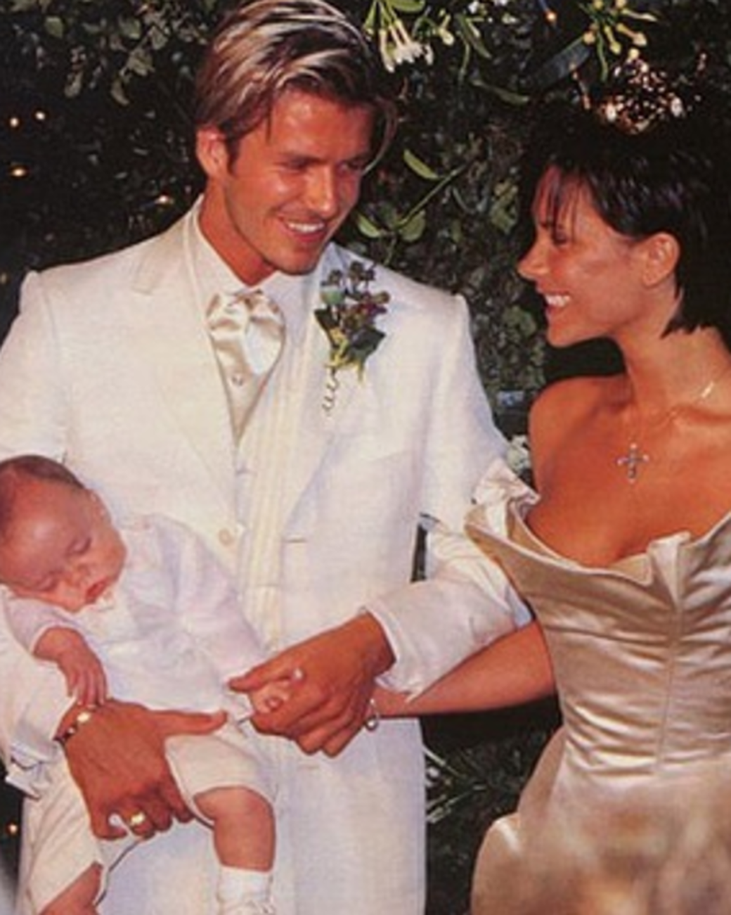 David and Victoria Beckham with Brooklyn Beckham at their wedding