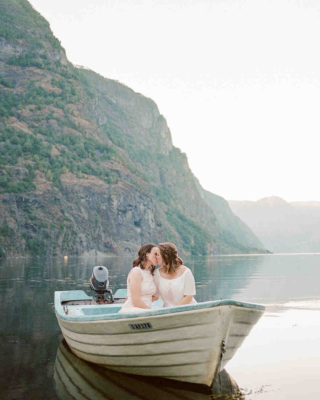 destination engagement couple love boat lake and mountain view