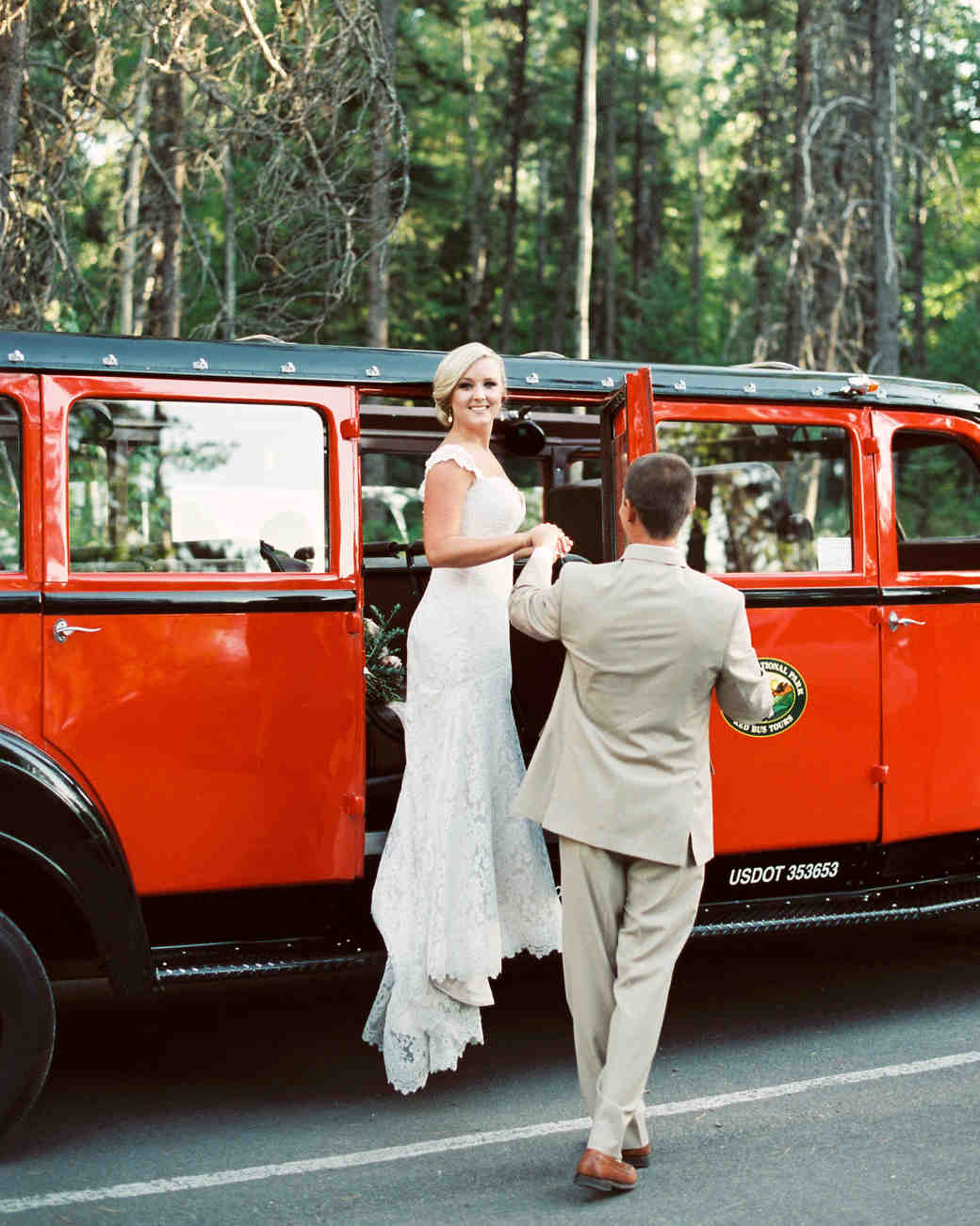bride and groom getting into a vehicle
