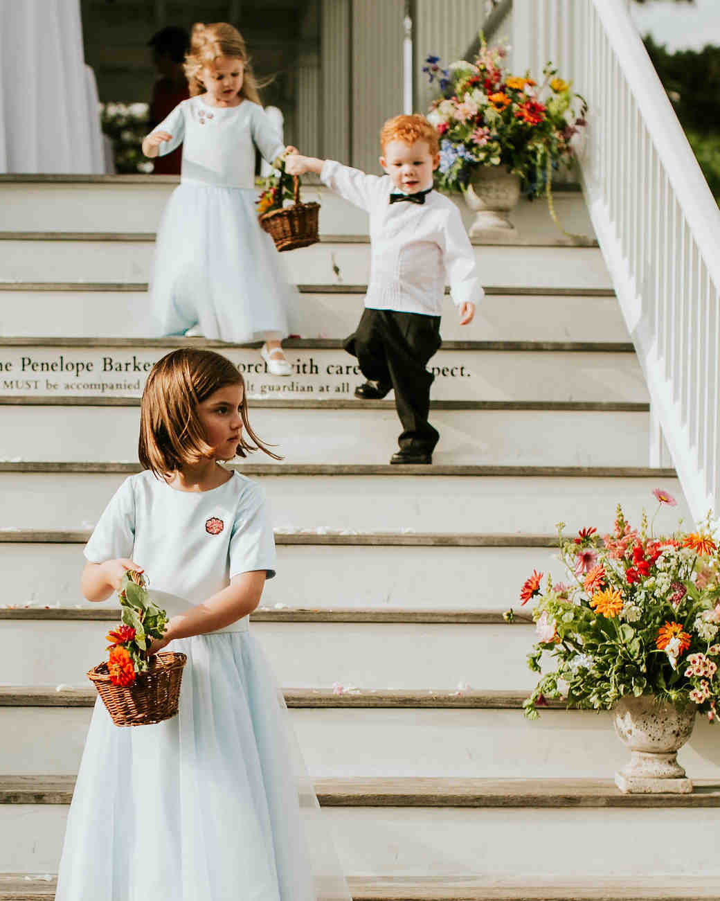 leah michael wedding flower girls ring bearer on stairs