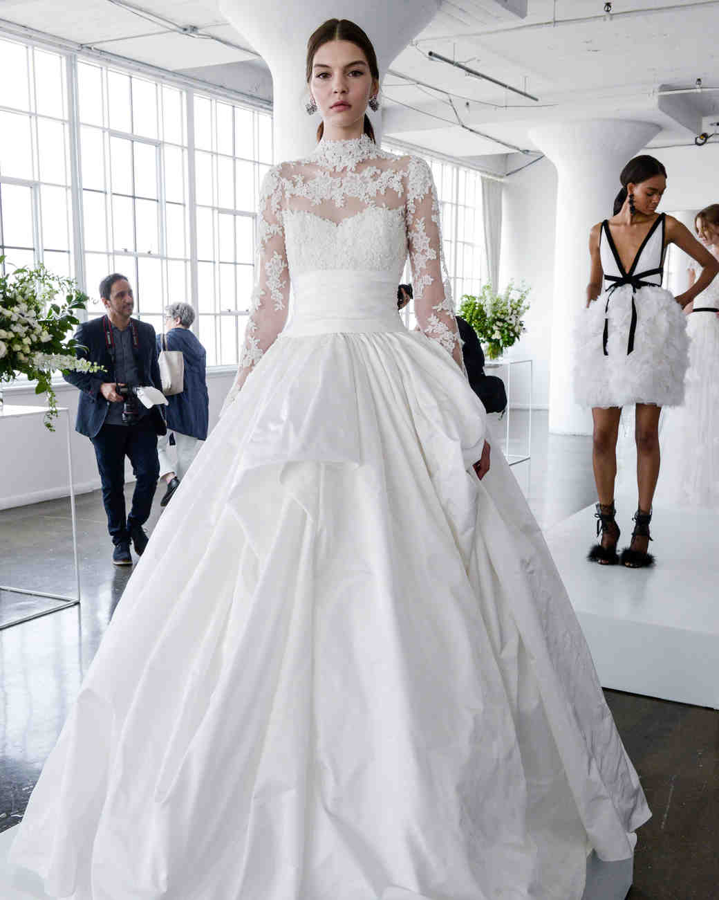 marchesa spring 2018 ball gown with a high lace neckline and long sleeves