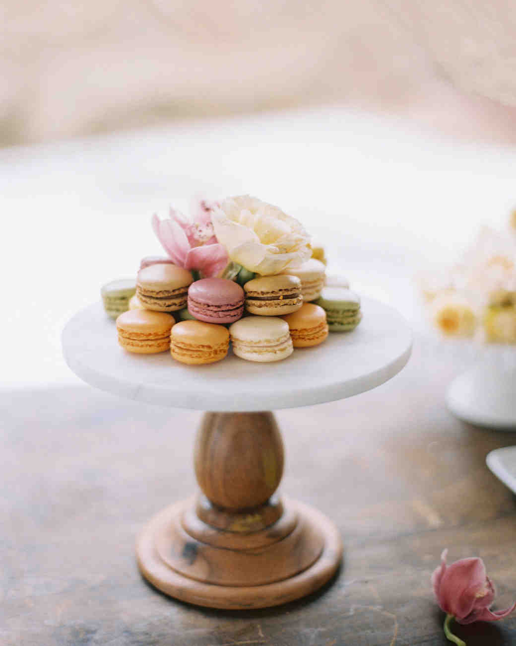 surprise wedding macarons arranged cake stand