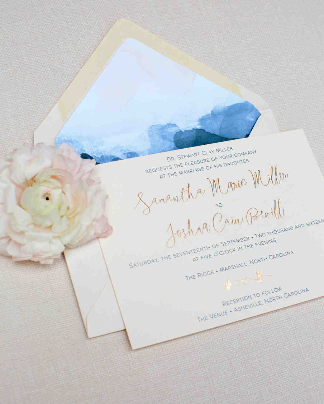 wedding invitation with blue envelope liner
