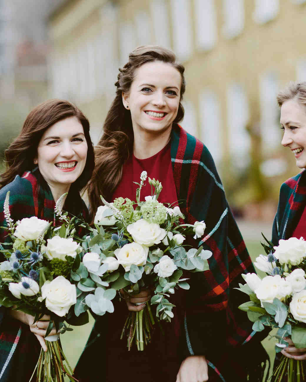 bridesmaids wearing plaid blankets