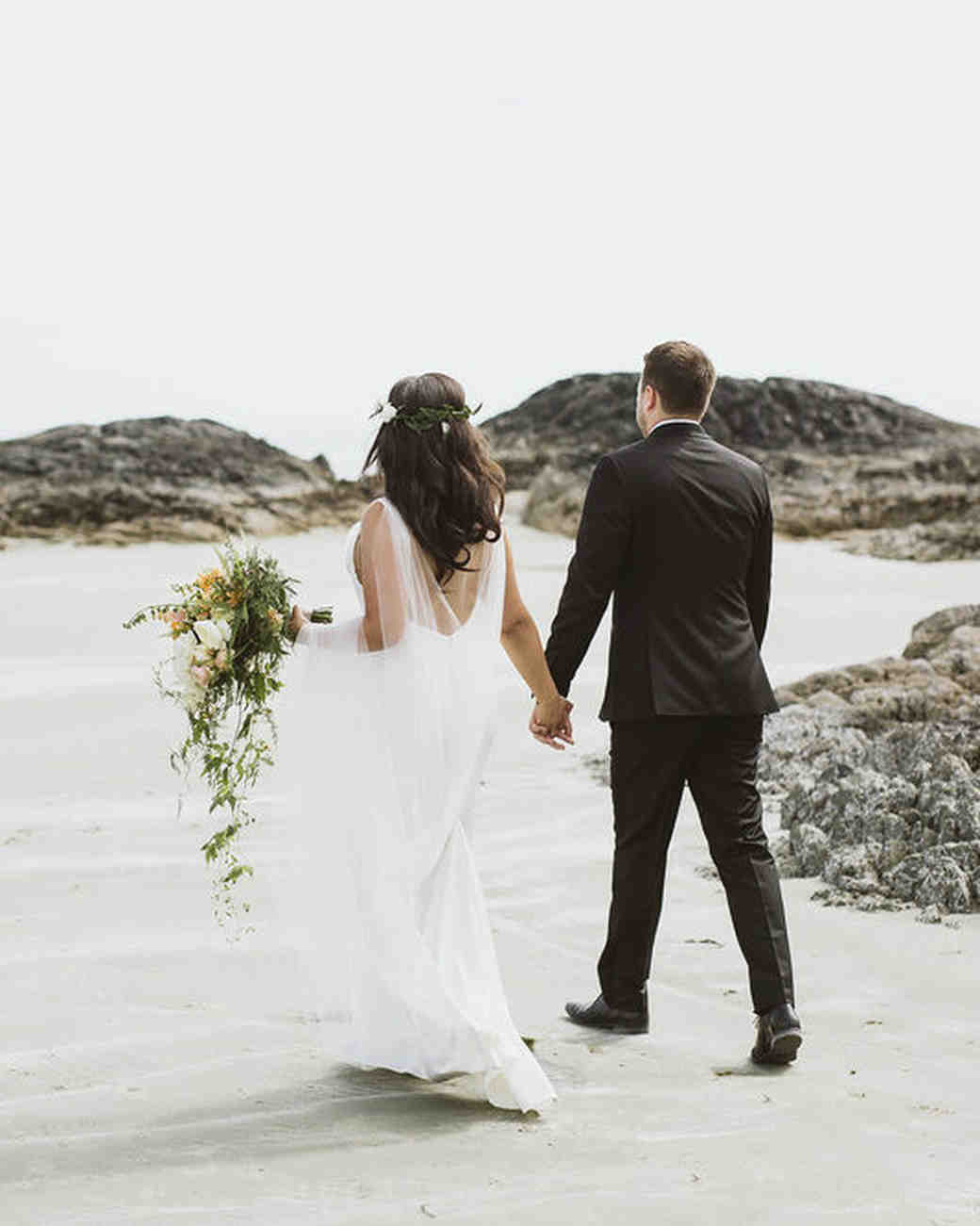 bride groom walking along beach