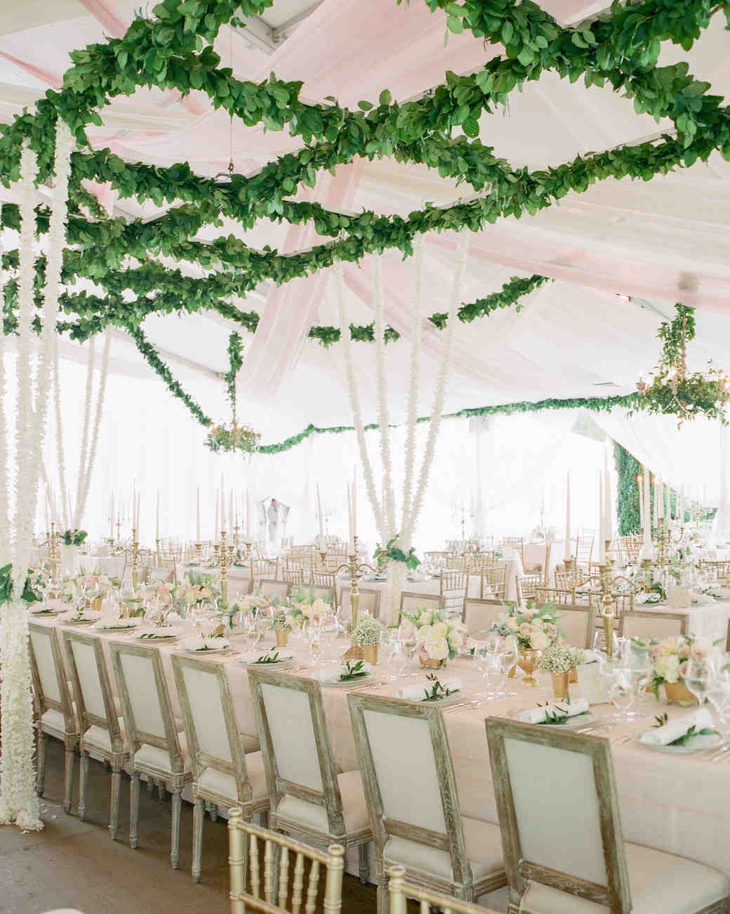 Long White Reception Table with Overhead Foliage