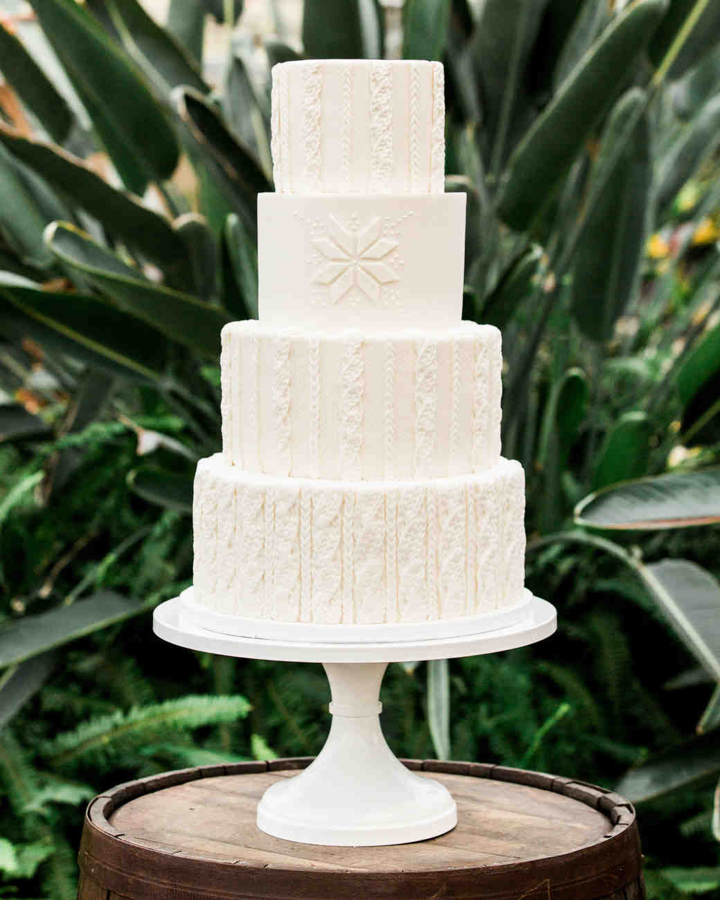 four tier wedding cake with sweater design