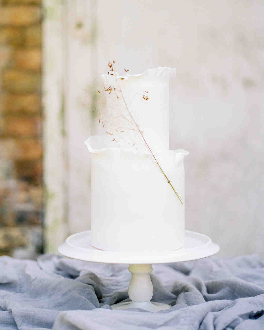 white wedding cake adorned with smokebrush sprig