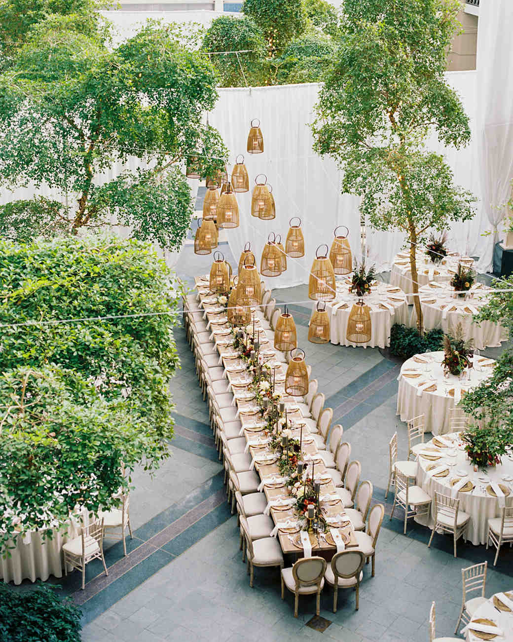 hanging Wooden Lanterns over reception tables