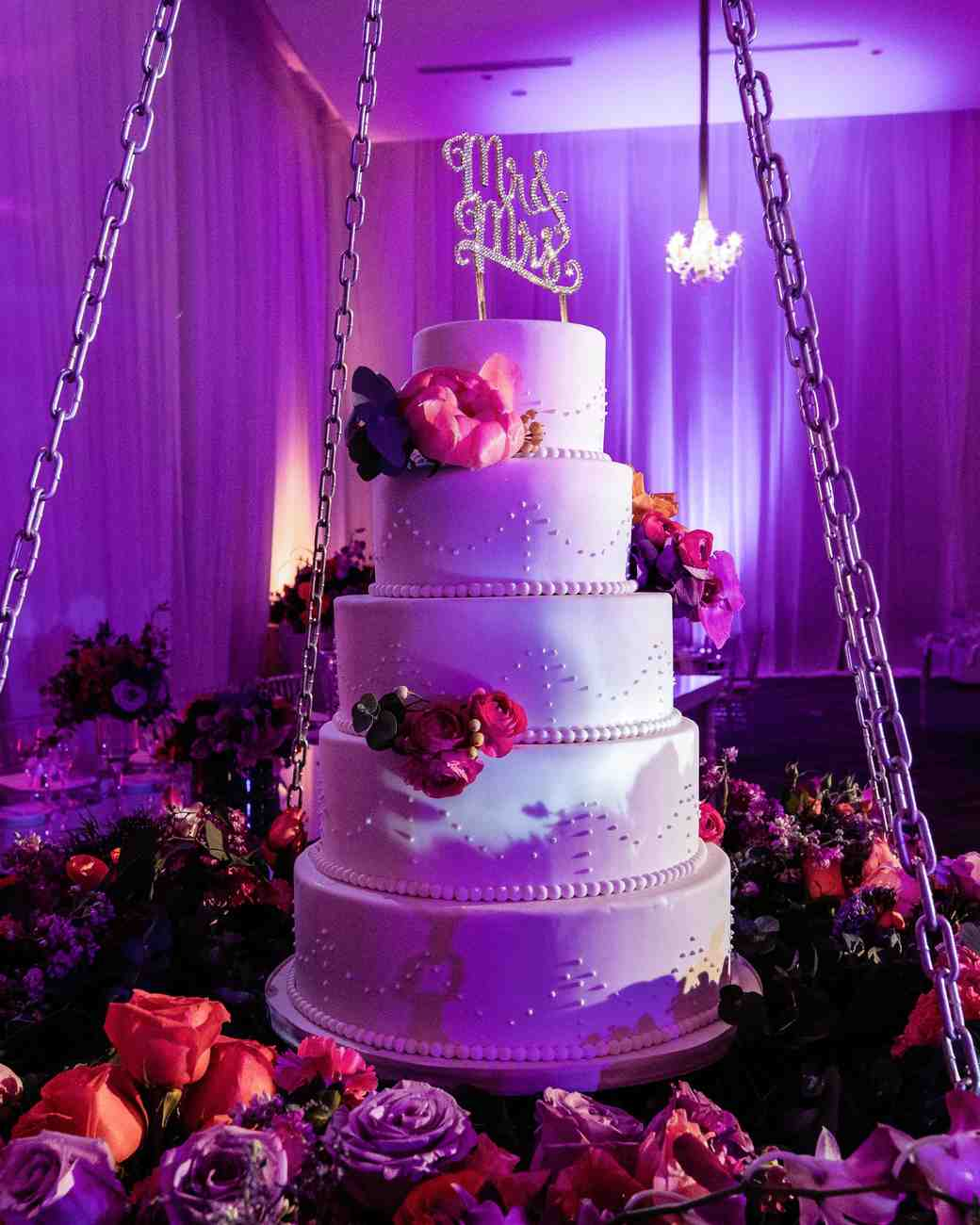 hanging five tier wedding cake rose base pink lighting
