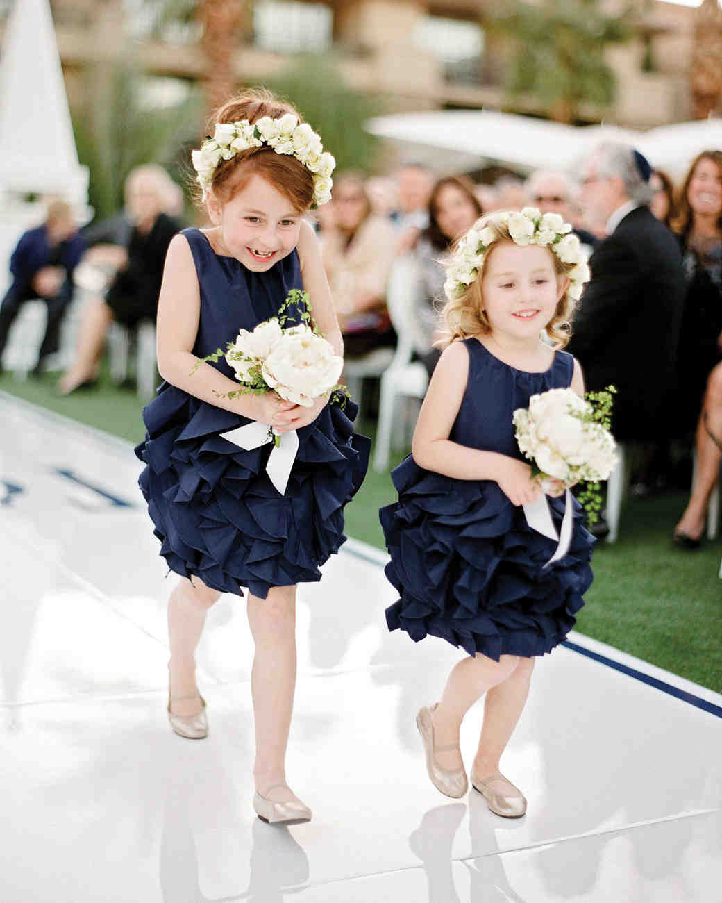 tali-mike-real-wedding-flower-girls-walking-down-aisle.jpg