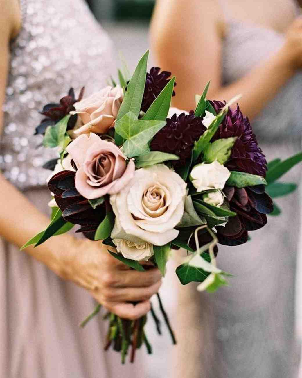 bridesmaid holding blush roses and dark purple dahlia bouquet