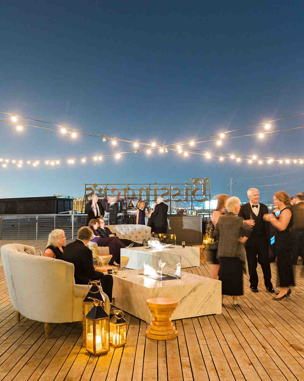 wedding cocktails rooftop string lights