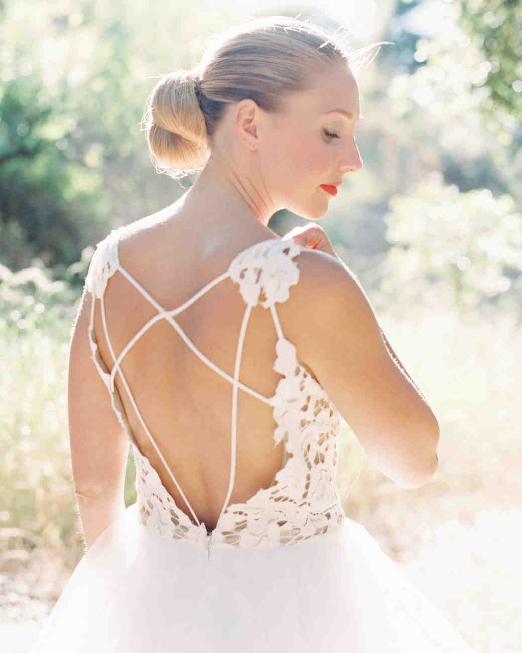 A Bride with a Wedding Dress That Features Lined Back Details
