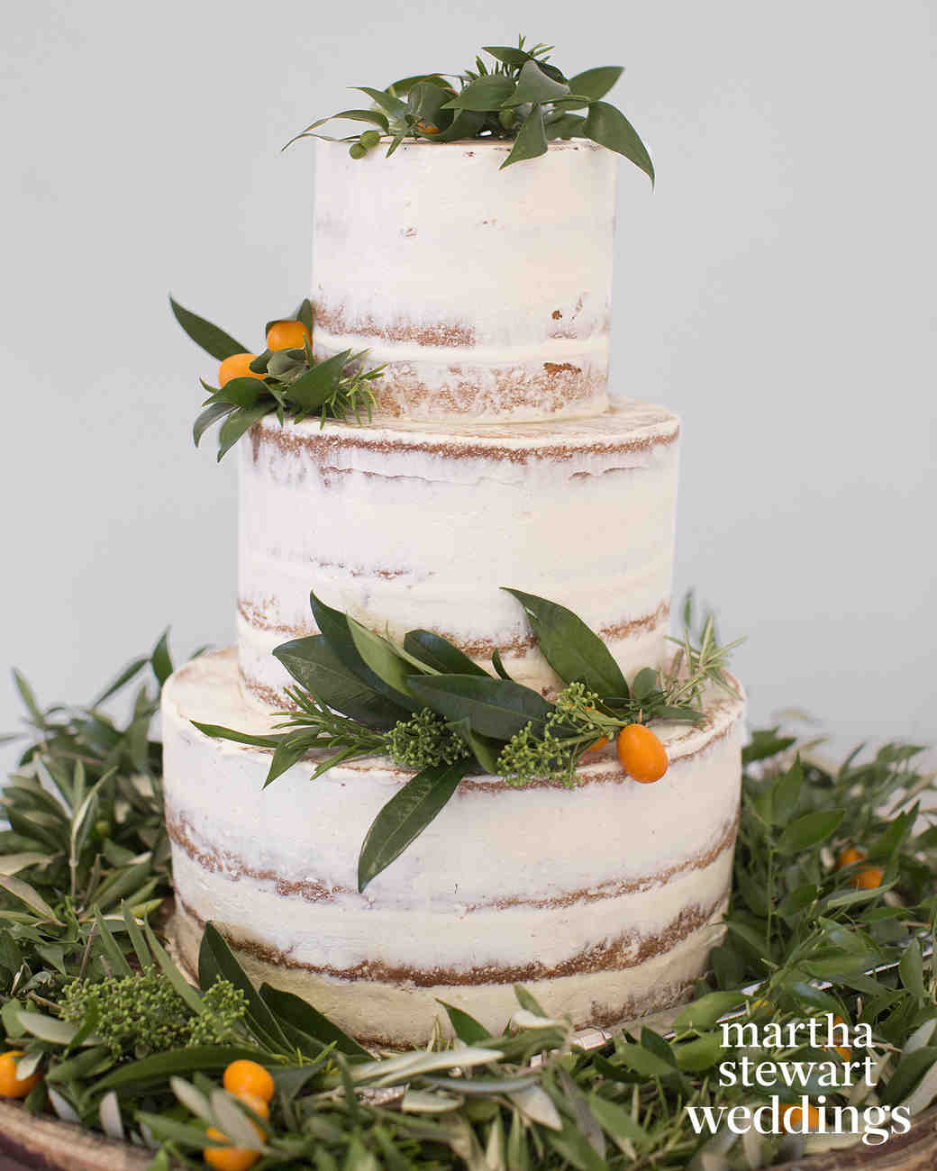Nearly Naked Wedding Cake with Greenery and Kumquats