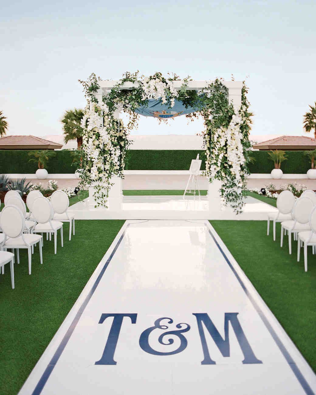 14 beautiful ways to elevate your ceremony aisle martha stewart monogrammed ceremony aisle junglespirit Image collections