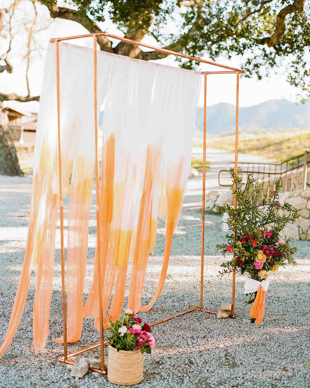 wedding backdrop dip dyed fabric copper structure flowers