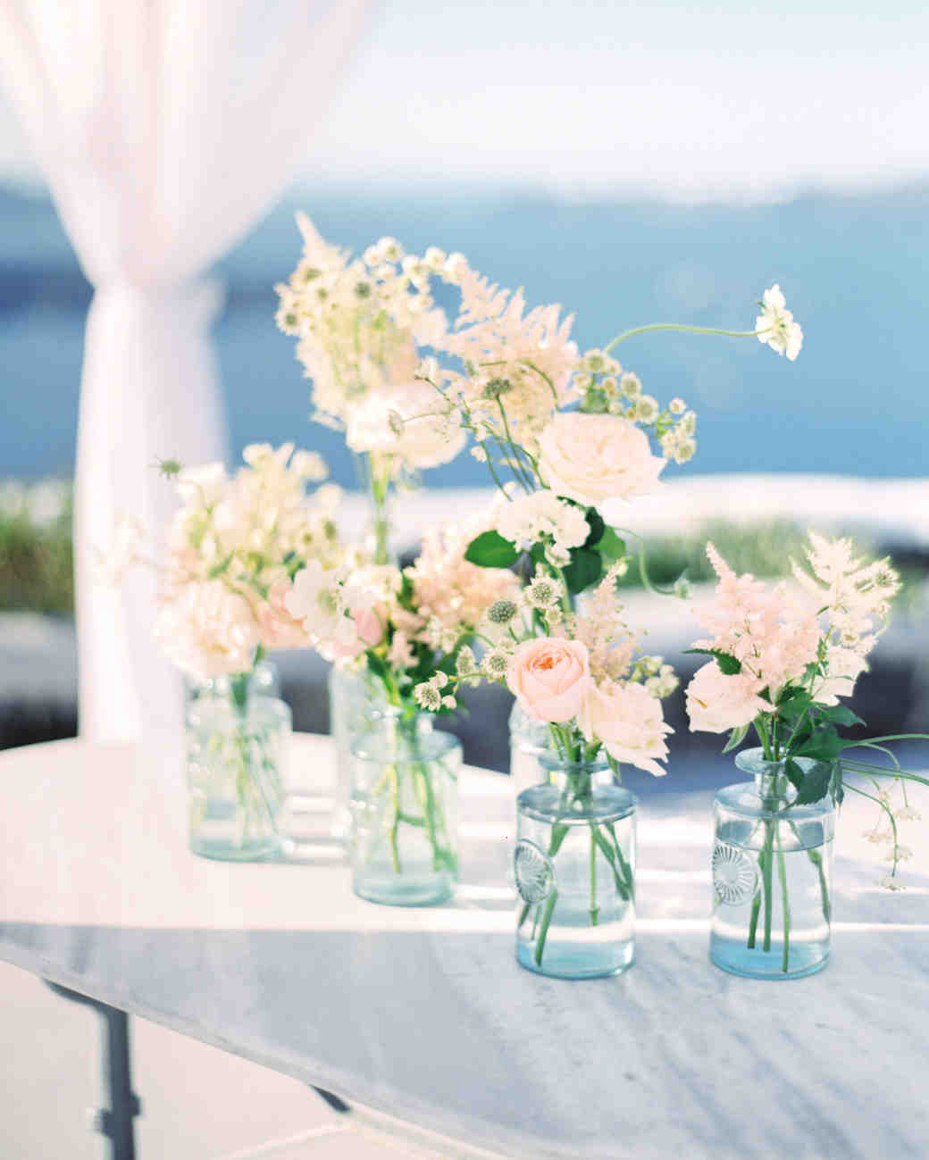 pink roses and white flowers in glass vases & Elegant and Affordable Wedding Flower Ideas We Love | Martha Stewart ...