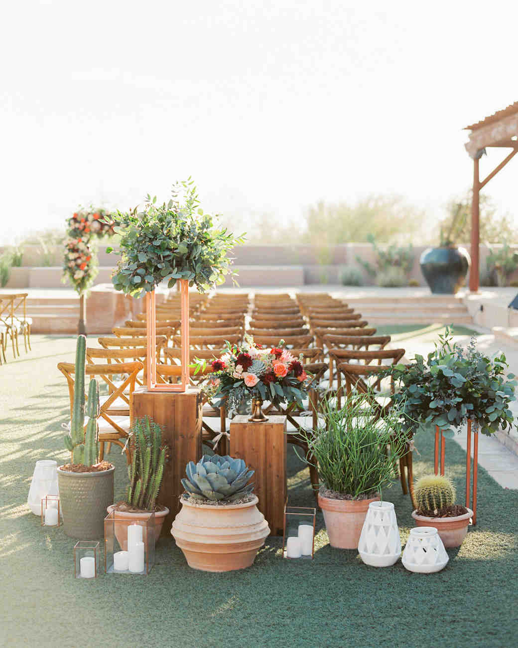last row ceremony chair decorations terra cotta pots and cacti