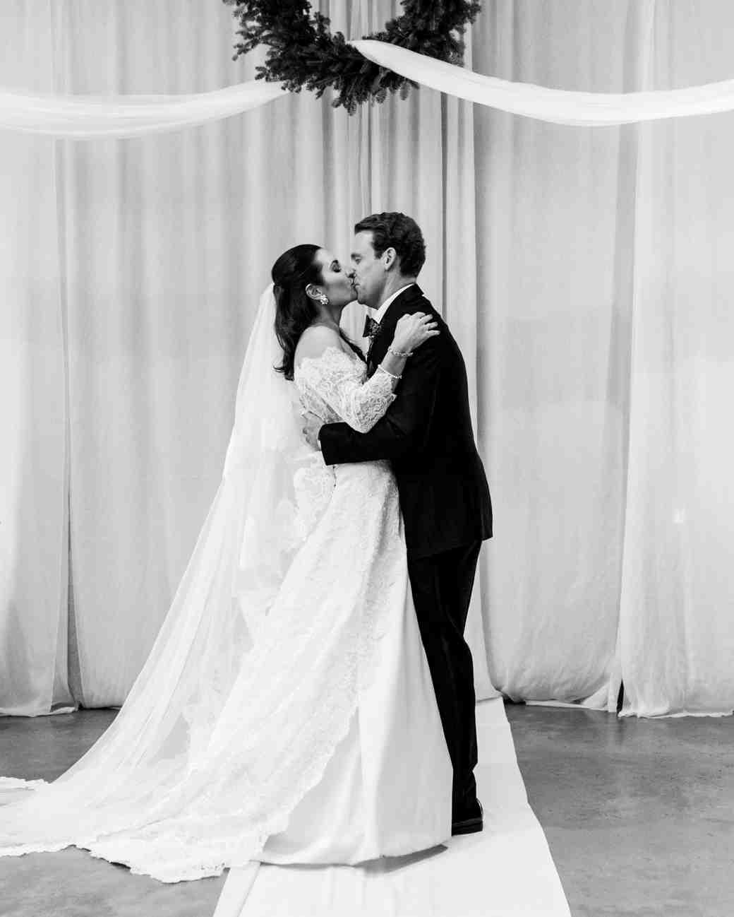 lauren christian christmas wedding ceremony couple kiss