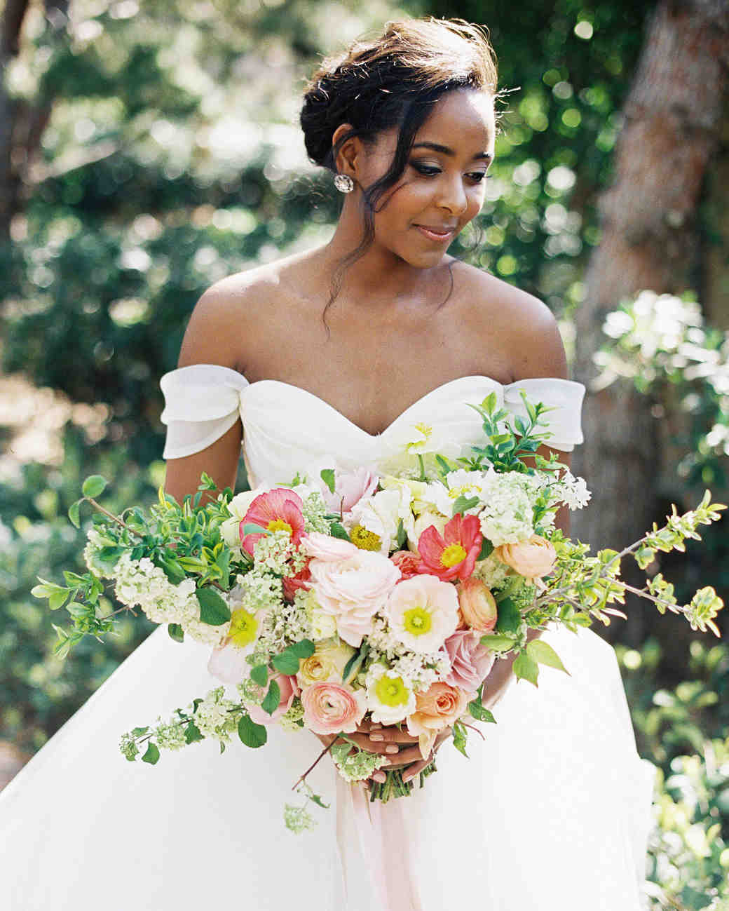 41 brides wearing off the shoulder wedding dresses martha stewart bride holding bouquet junglespirit Image collections