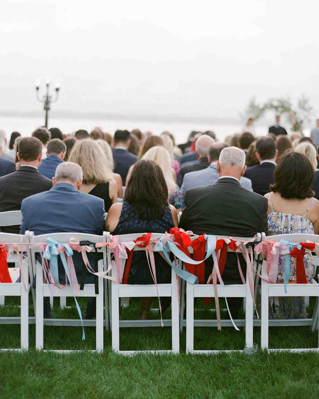 colleen stephen newport wedding ceremony chairs backs decorated with ribbon