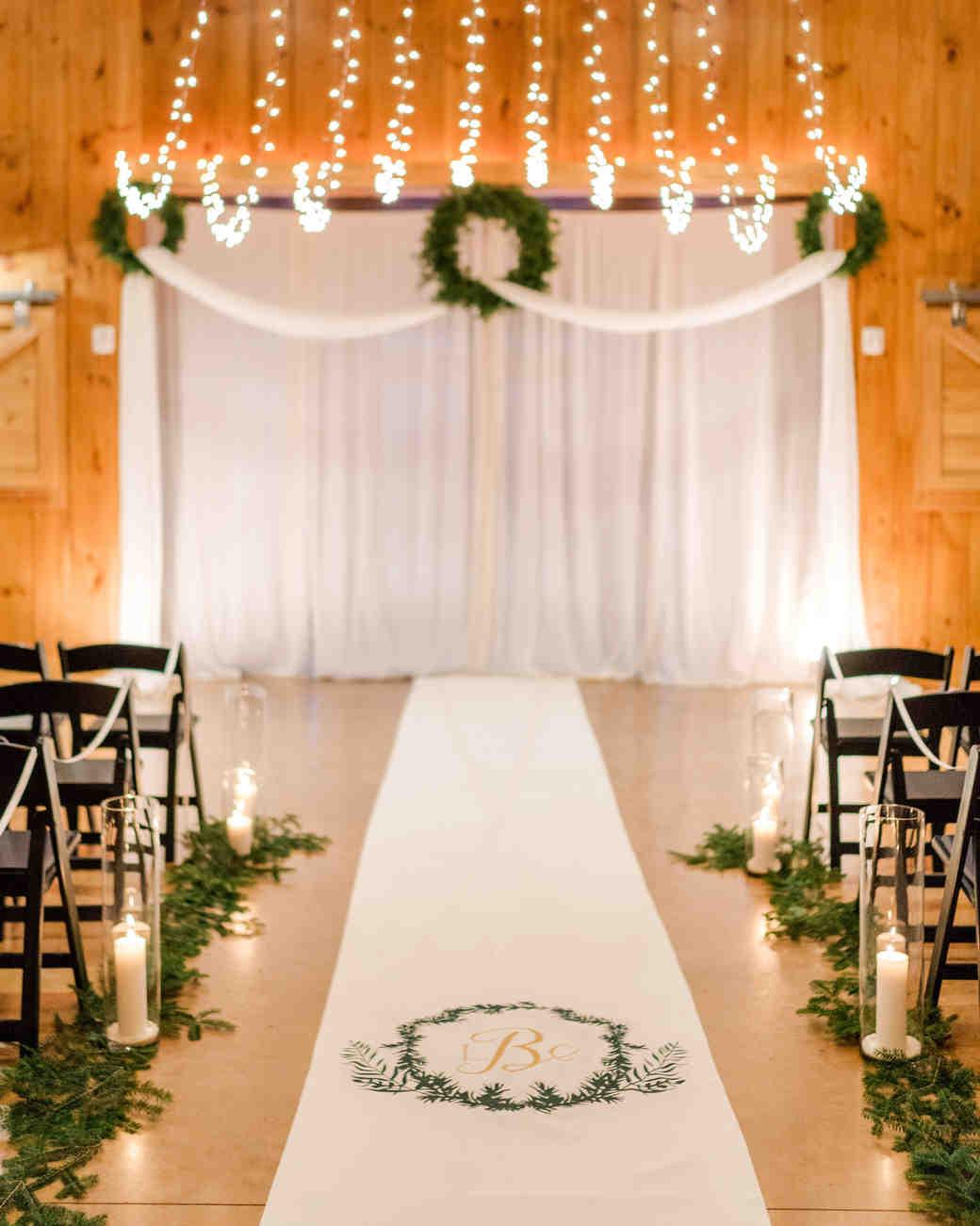 lauren christian christmas wedding ceremony aisle monogrammed runner lights