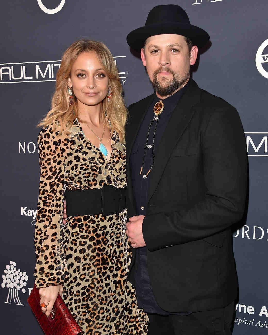 celebrity couple nicole joel black suit leopard print dress