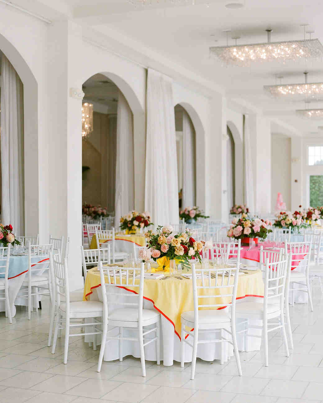 colleen stephen newport wedding white reception tables with multi-colored table cloths