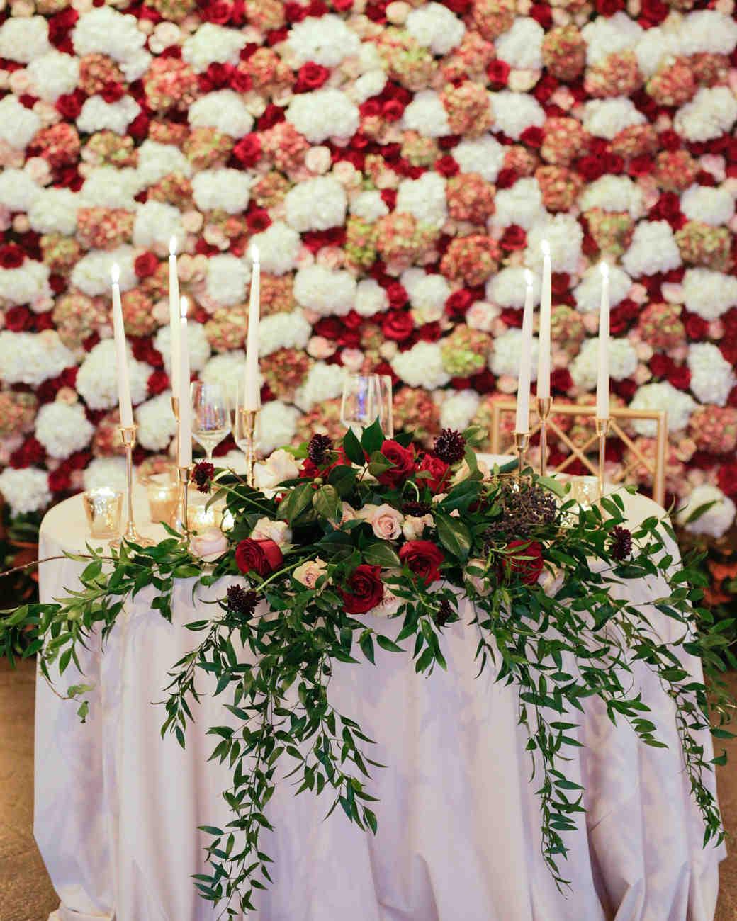 elizabeth seth wedding sweetheart table with flower wall backdrop